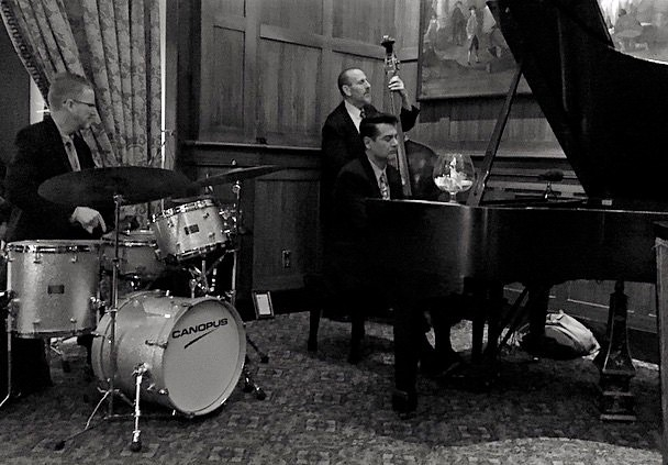 The Tony Pacini Trio delights a listening audience in a luxury hotel:  (Tony Pacini piano, Ed Bennett bass, Timothy Rap drums). Photograph by: David Yaw.